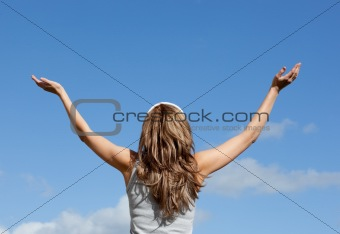 Blond woman relaxing against blue sky