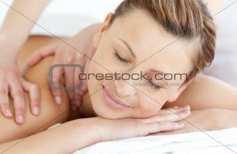 Charming woman enjoying a back massage