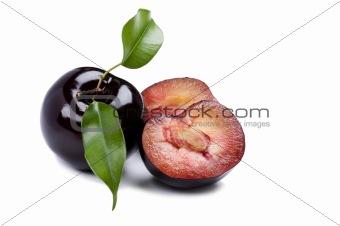 Cutting plum on white