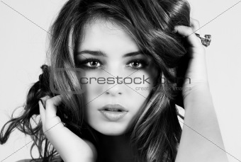 Beautiful Young Woman With Hands in Her Hair