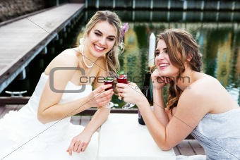 Young Women in Gowns Sharing a Drink