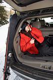 Teenager sleeping in car.