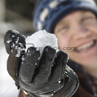 Teenager holding a snowball.
