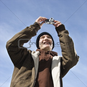 Teen taking picture.