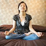 Female meditating.