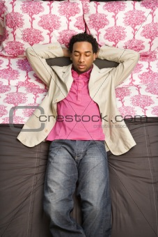 Man laying on bed.