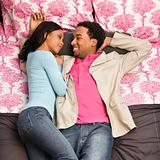 Couple laying on bed.