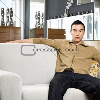 Portrait of male on couch.