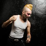Punk with clenched fists.