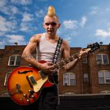 Punk playing guitar.
