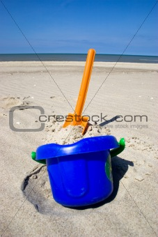 Beach spade and bucket