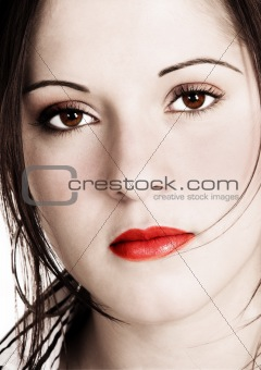 Beautiful woman with sepia look and saturated added colors