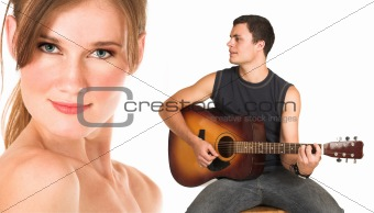Face of a beautiful nude woman with man playing guitar