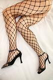 Woman in fishnet stockings.