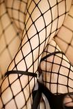 Woman in fishnet stockings.