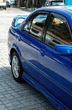 Rear view of blue sportive car