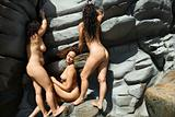 Three nude women.