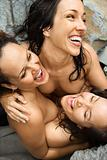 Three women embracing.