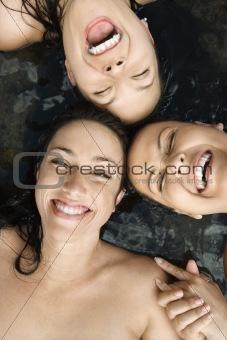 Three nude women.