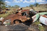 Rusty car in junkyard.