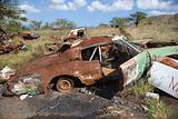 Rusty car in junkyard.