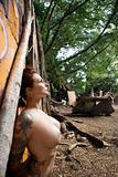 Sexy tattooed nude woman.