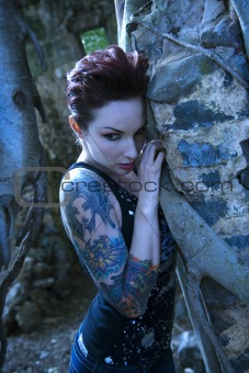 Portrait of tattooed woman.