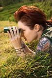 Tattooed woman with binoculars.
