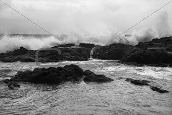 Waves crashing on rocky shore.