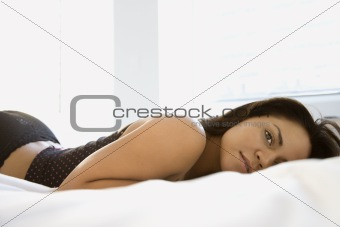Woman on bed.