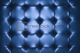 Blue leather cushion.