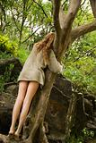 Woman hugging tree.