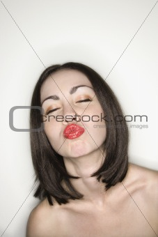 Nude woman puckering lips.