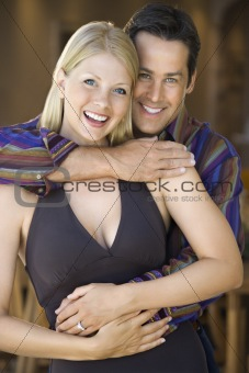 Caucasian couple smiling.