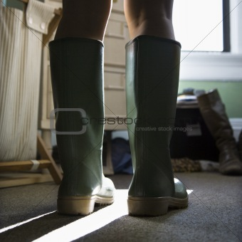 Green rubber boots.
