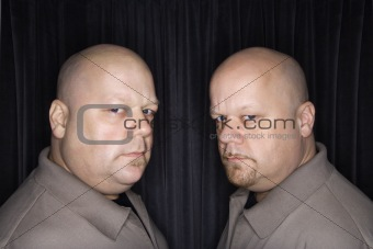 Bald twin men.