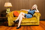 Woman sitting on retro couch.