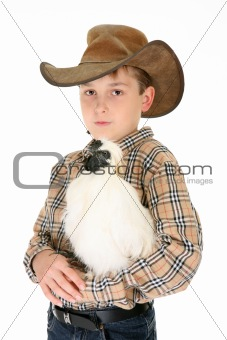 Country boy holding a chicken