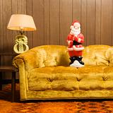 Santa figurine on couch.