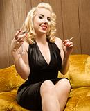 Woman holding martini and cigarette.