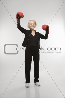 Woman wearing boxing gloves.