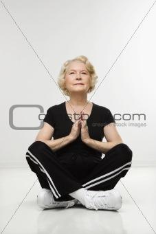 Senior woman meditating.