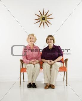 Women sitting smiling.