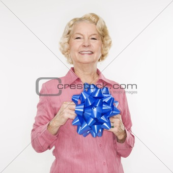 Woman holding bow.