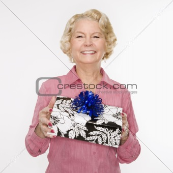Woman holding present.