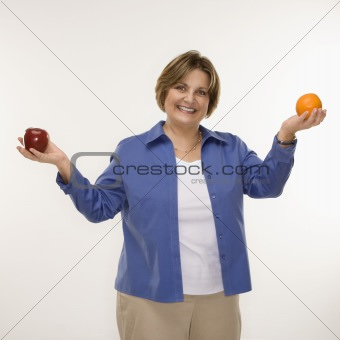 Woman holding fruit.