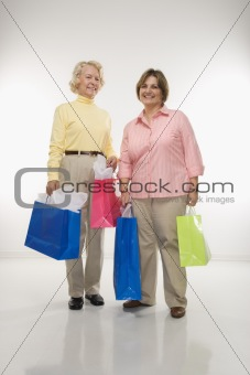 Women holding gift bags.