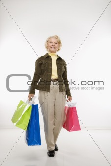 Woman holding gift bags.