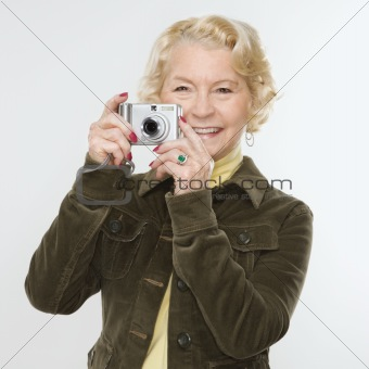 Woman using digital camera.