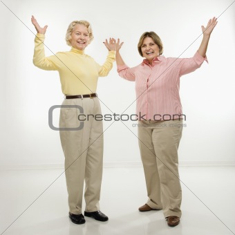 Women with arms in air.